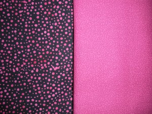 On the left:  Black and magenta dotted cotton batik.  On the right: Light magenta with dark magenta squiggles.