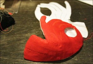 Mask shape covered with red cotton